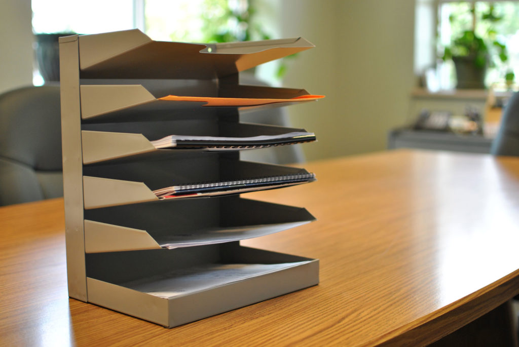 Metal tray displayed on conference table