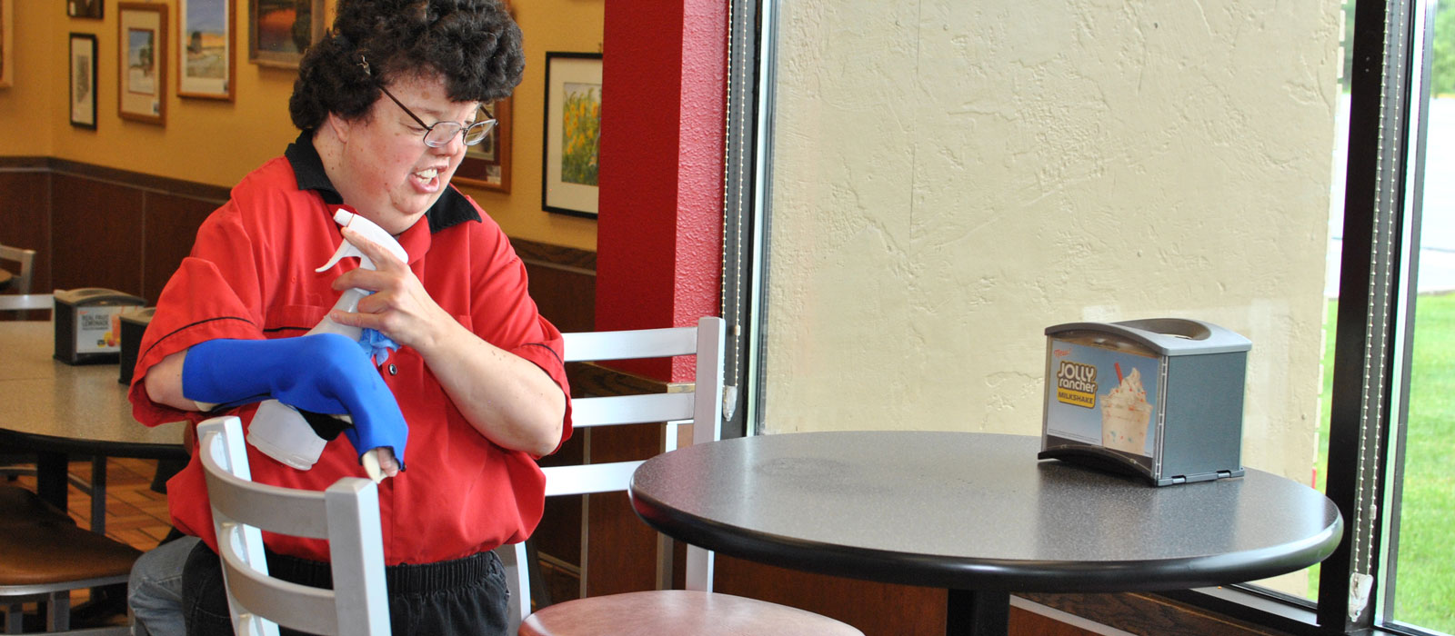April cleaning a table at Hardees in I. Falls
